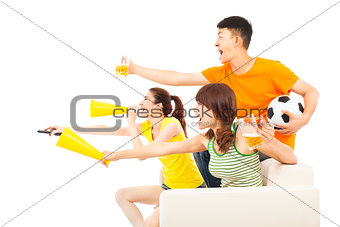young people so excited to yelling  and while watching soccer ga
