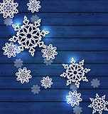 Christmas set snowflakes on wooden background