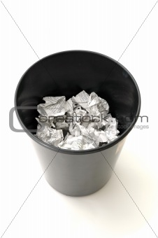 Bin half filled with paper