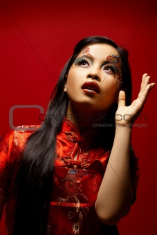 Asian Plastic Doll