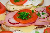 Tomato radish, ham, cheese and chive on sandwich