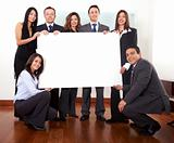 office team holding a cardboard