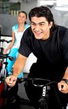 man cycling at the gym