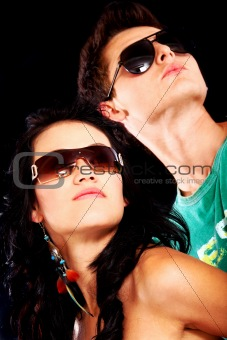fashionable couple with sunglasses