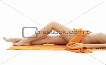 long legs of relaxed lady with orange towel #4