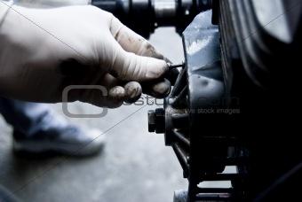 Mechanic fixing an engine