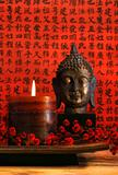 Asian candle with red oriental background