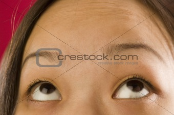 Asian womanÕs eyes looking up