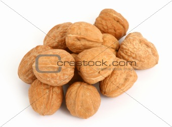group of walnuts against white