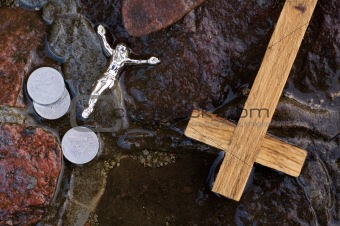 Cross, coins and Jesus figure.