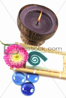 Candle, soap and flower.