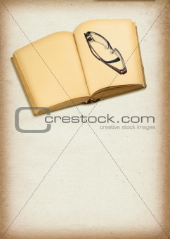 old blank book and glasses