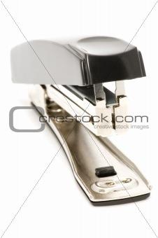 black stapler on white