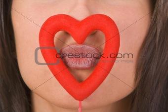 Kissing through the heart
