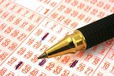 lottery ticket and pen