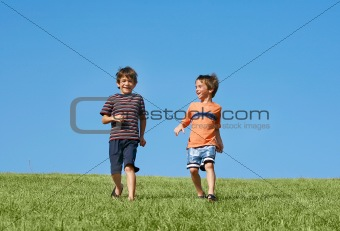Boys Running Down A Hill