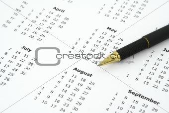 calendar and ballpoint pen
