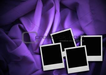 four photo frames against textile background