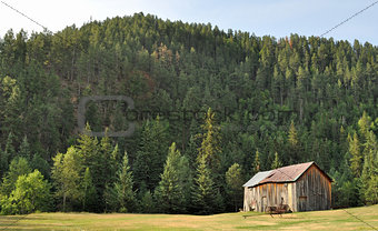 Old barn sitting on the hillside
