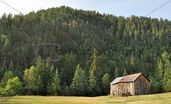 Old barn sitting on the hillside