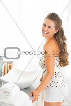 Portrait of smiling young woman in bathroom
