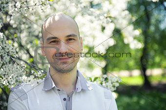 Portrait of smiling man in the park