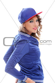 Beautiful colored girl with curls wearing a cap