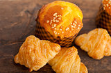fresh baked muffin and croissant