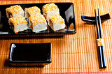 traditional Japanese rolls on a black dish