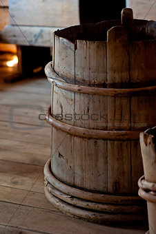 Old wooden bucket close-up in house
