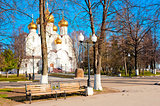 White church with golden domes in the park