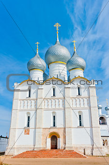 beautiful white stone Orthodox Cathedral with gray domes