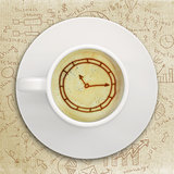 Picture of the clock face in the coffee foam
