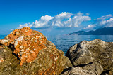 Rocks, sea and blue sky with clouds