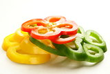 red, yellow and green bell pepper sliced ​​on white background