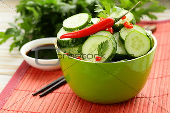 cucumber salad with red chili pepper and cilantro, Asian food