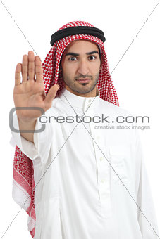 Arab saudi man gesturing stop with his hand