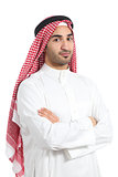 Serious arab saudi emirates man posing with folded arms