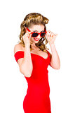 Girl adjusting glasses to flashback a 1950s look