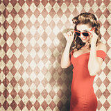Vintage pinup fashion model in womens sunglasses