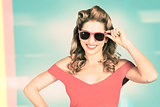 Pinup girl fashion model wearing summer sunglasses