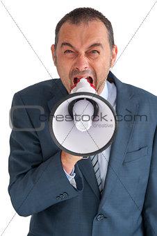 businessman shouting through a loudhailer