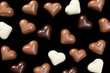 chocolate hearts on black
