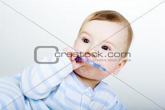 Little baby boy gnaws toy