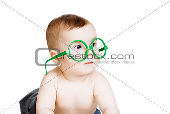 Little baby boy in the big funny glasses. isolated on white back