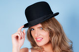 woman wearing a bowler hat