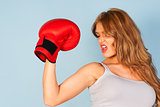 woman in vest wearing red boxing gloves