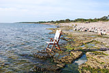 Chair at flat rock coast