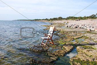 Chair at flat rock coast