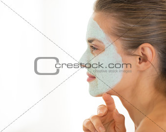 Portrait of young woman wearing facial cosmetic mask